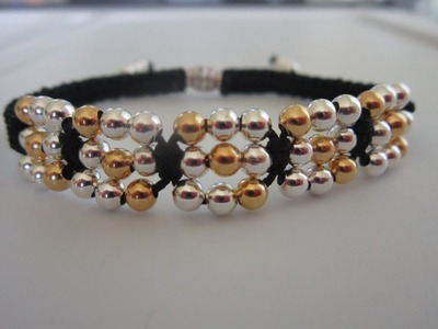 Shamballa Bracelet with metal beads . Gold and Silver metal beads .
