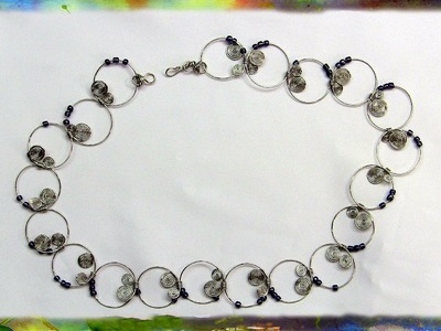 How to Create the Beautiful Spiral Hoop Necklace with Purple Beads by Ross Barbera