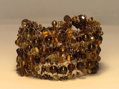 Handcrafted Knitted Wire Bracelet with Brown and Gold Coloured Glass Beads and Seeds.m2ts