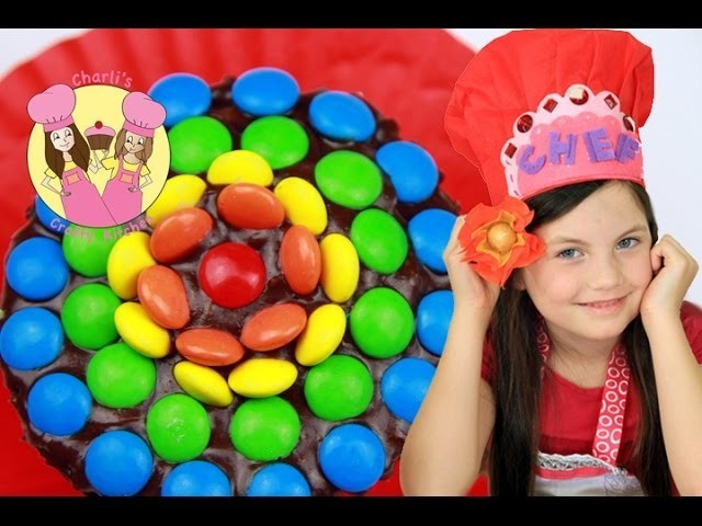 RAINBOW FLOWER CUPCAKES Make these chocolate frosted cupcakes with mini M&Ms for your party