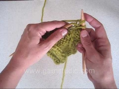 DROPS Knitting Tutorial: How to knit a cable without a cable needle