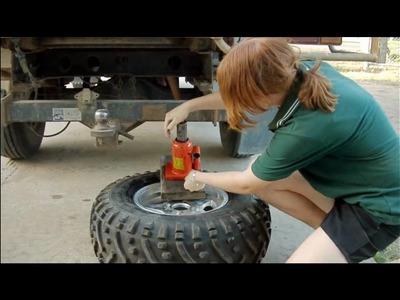 Debeading a tyre from an ATV rim. wheel