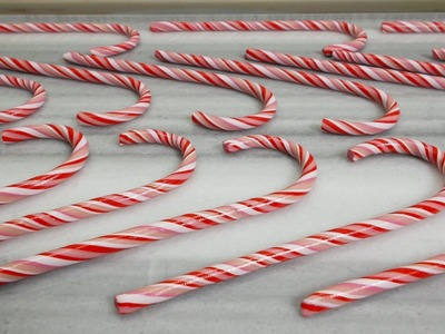 DIY- Polymer clay candy-canes. They ☼GLOW☼ in the dark!