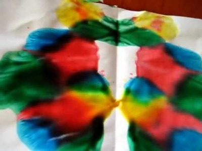 "Arts & Crafts activity idea: Symmetrical folding ""Butterfly"" painting."
