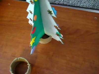 Christmas.Arts and crafts: Painted cardboard stand-up trees activity. Add stars or stickers.
