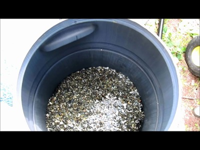 DIY Rain barrel made into pressurized homemade pond filter for water and algae . .