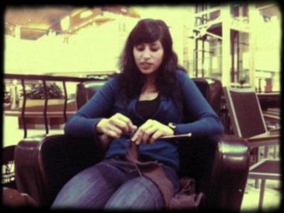 Girl Knitting And Talking
