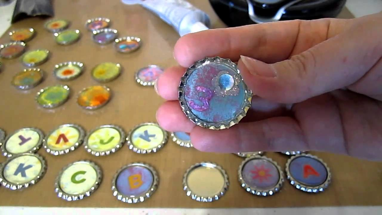 DIY Bottlecap Necklaces snap these caps onto a washer and fabric strip