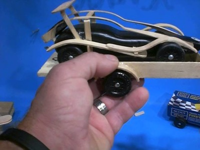 Craft Sticks attached to Pinewood Derby Cars