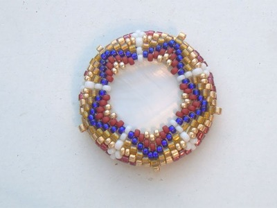 BeadsFriends: Beaded bezeled mother of pearl disc with Peyote Stitch (Star Bead Pattern)