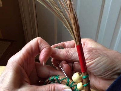 Inserting beads into pine needle baskets