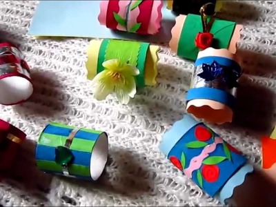 Arts and Crafts colorful napkin holders from toilet paper rolls.