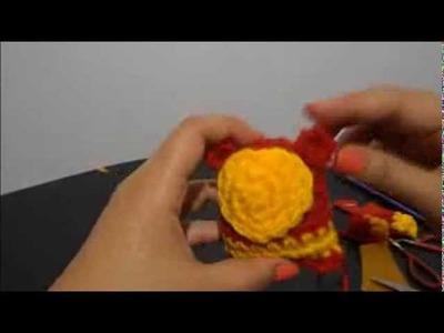 A mini crochet teddy bear