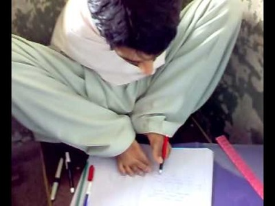 A student who has no arms and he is writing with his feet