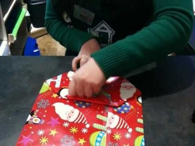 Folding a gift bag at Tree Town Toys