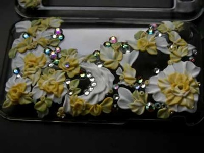Crystal case for iPhone 3G incrusted with SWAROVSKI and decorated with handmade flowers.