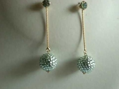 Swarovski crystal dangling ball earrings green chrysolite