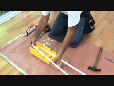 Cutting quarter round trim for a laminate floor
