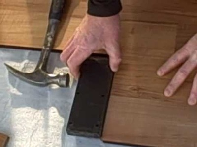How to Install Laminate Flooring, Part 1 - Tapping Block