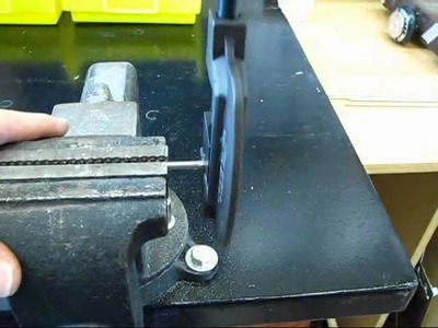 Using a hand tool to knurl a meccano shaft