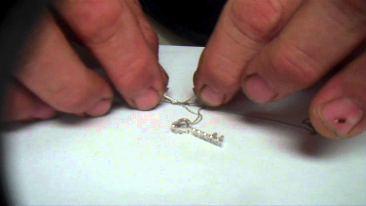 How to untangle a chain, untangle jewelry, knot out of a neclace, knot out of a chain.