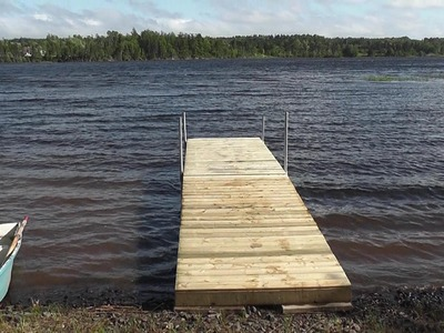 How to build a floating dock using barrels.   detailed step by step instructions