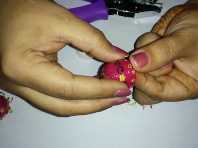 44. How to punch holes in paper Jhumka and attach latkans. loreals