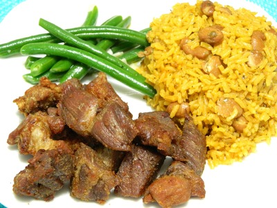 How to make Puerto Rican Carne Frita with Arroz con Habichuelas