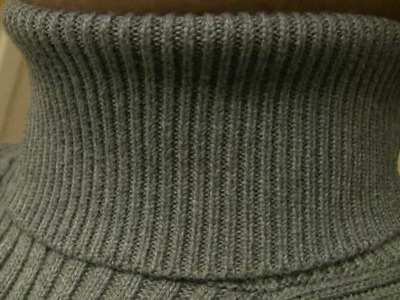 A bit tighter and tightlly ribbed grey turtleneck in high definition