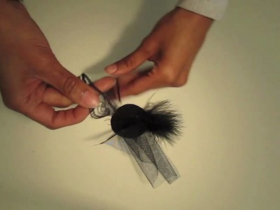 How to make a brooch using a Feather duster, button and clip of fabric