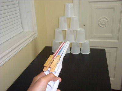 Making a gun that shoots elastic bands out of paper