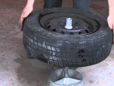 Balancing a tire with a bubble balancer