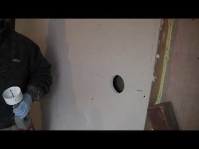 Drill Holes for Cellulose Insulation Installation