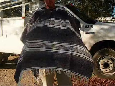 Making a poncho from a horse blanket. wmv