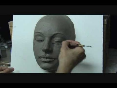 Sculpting a  female face in clay. Demo how to sculpt a face.