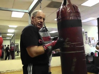 Working the uppercut on a heavy bag