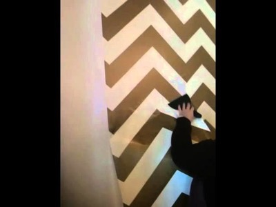 Interior Designer, Kent, is installing temporary chevron wall paper at Blue Hand Home!
