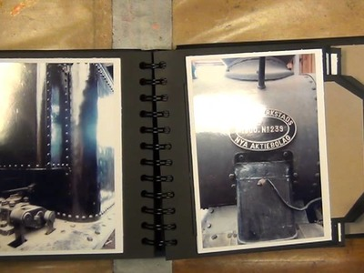 A MINI ALBUM WITH A HIDDEN COIL BINDING AND SLIDER TAGS