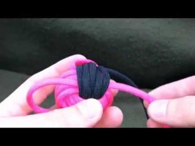 Paracordist how to TIGHTEN a two color monkey's fist knot made with paracord and a jig