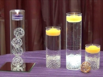 Centerpiece idea - tea light cylinders - from Surroundings.com