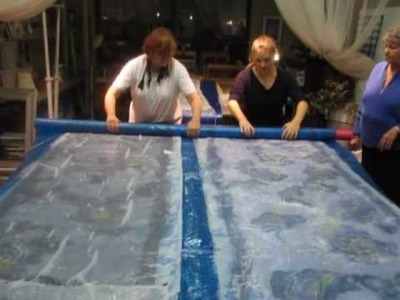 Making Nuno Felt: Wrapping the Scarves in Bubble Wrap to Get Ready to Roll