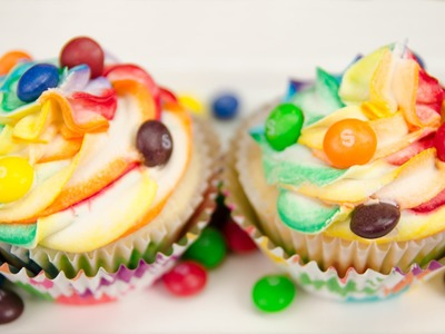 Skittles Cupcakes with Rainbow Icing from Cookies Cupcakes and Cardio