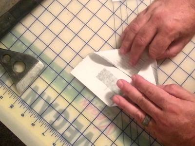 Making paper envelopes for seeds.