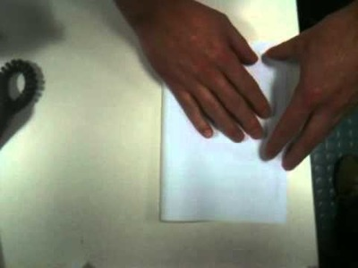 """How to"" with Rich and Russ. Folding a piece of A4 paper to A5."