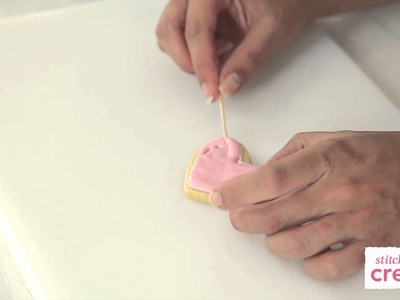 How to flood a cookie with royal icing and add polka dots | Cake Craft Made Easy