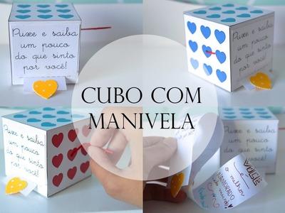 Cubo com manivela e carta de metro
