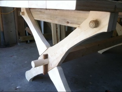 Build a table that is held together with 2 wedges and 4 dowels. Knock down furniture.Trade secret.
