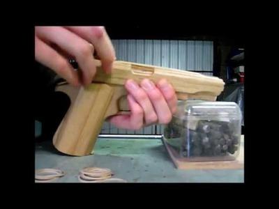 Loading the blowback rubber band gun