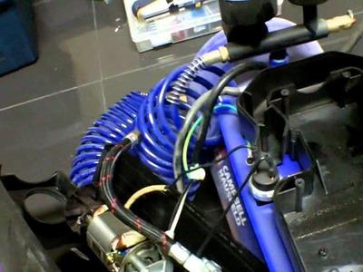 Silent air compressor using a refrigerator compressor.