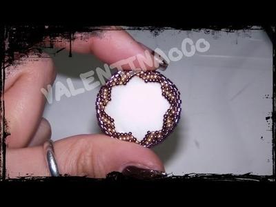 Tutorial - Incastonare una madreperla-pietra con decorazione a stella alternando le rocaille.